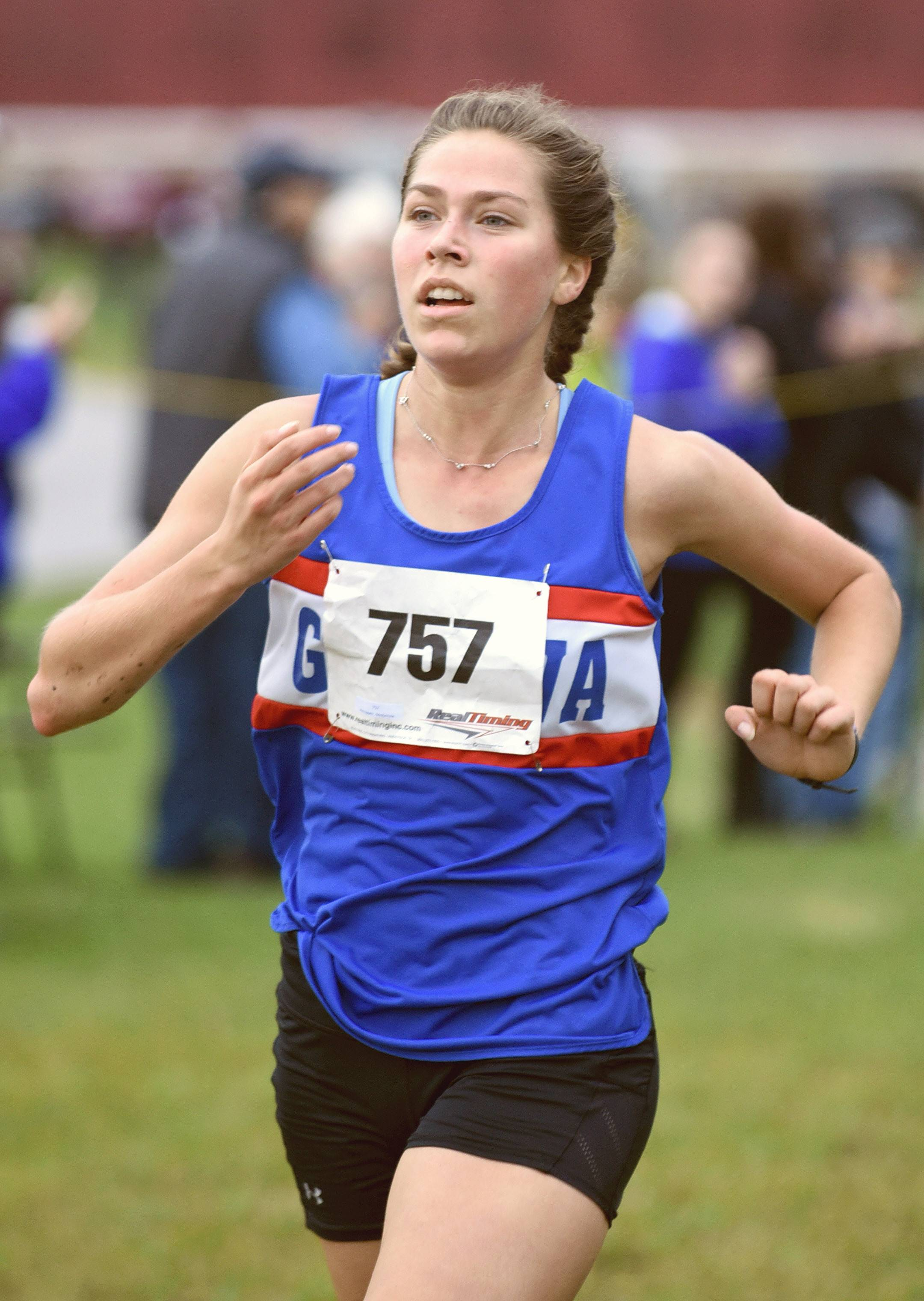 Geneva's McKenzie Altmayer takes first place in the girls varsity race with a time of 18:04.2  at the St. Charles North cross country regional on Saturday.