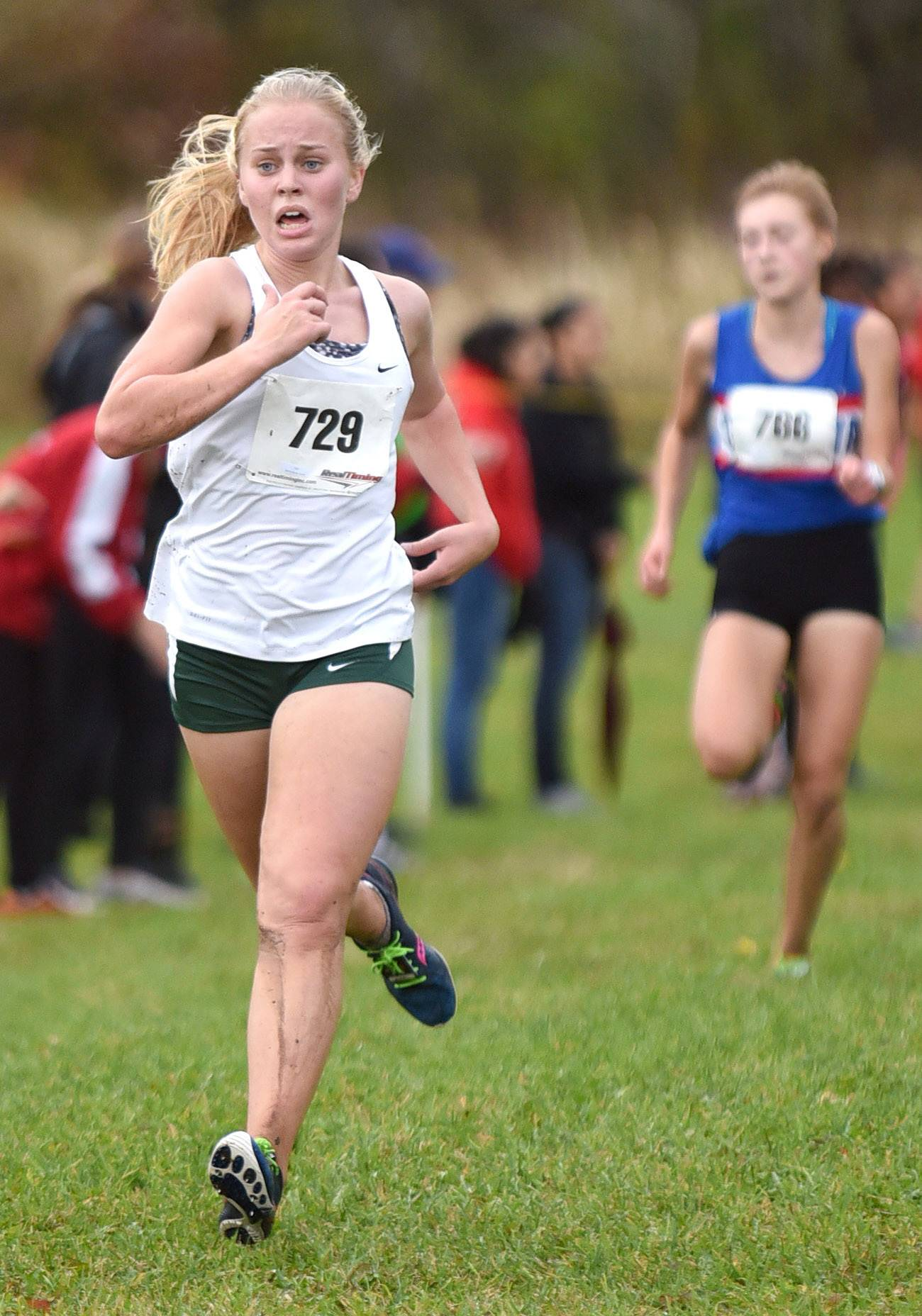 Bartlett's Coral McFarland nears the finish in the girls varsity race to take 17th place with a time of 20:09.2 at the St. Charles North cross country regional on Saturday.