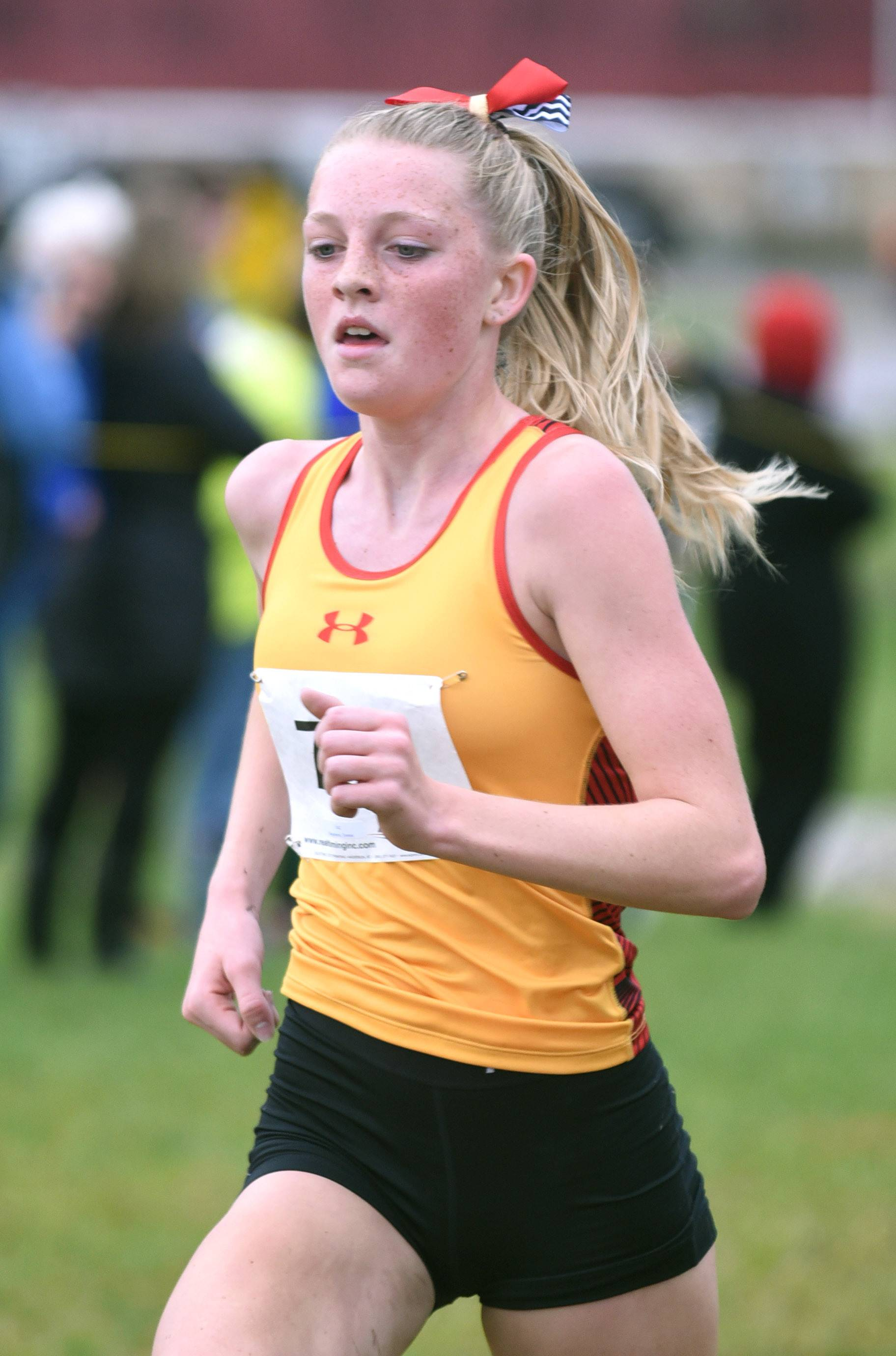 Batavia's Emma Stephens takes second place in the girls varsity race with a time of 18:18.4 at the St. Charles North cross country regional on Saturday.