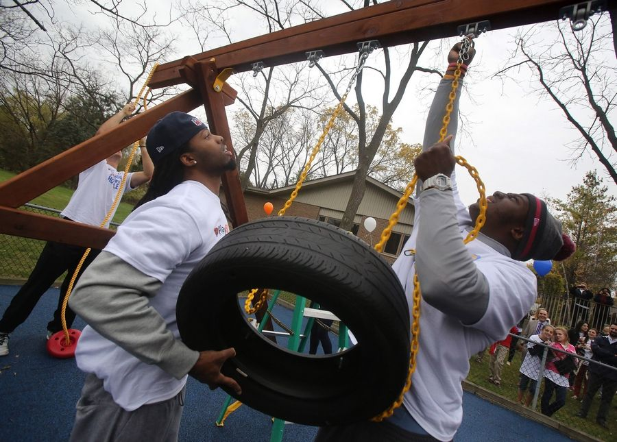 Chicago Bears rookies Kevin White, left, and Khari Lee work on a playground at the Zacharias Sexual Abuse Center in Gurnee on Tuesday. The players worked with staff and landscapers to create Chicago Bears' Play Zones in conjunction with United Way Hometown Huddle.