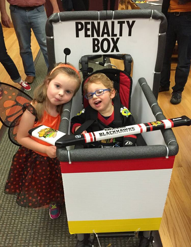 Fun costumes make it easy for siblings Eleanor and Sheldon Rognstad of Des Plaines to share a smile this Halloween. The 4-year-old girl's metamorphosis into a butterfly is easy, but it takes a little work to convert her younger brother's wheelchair into a mobile hockey penalty box.