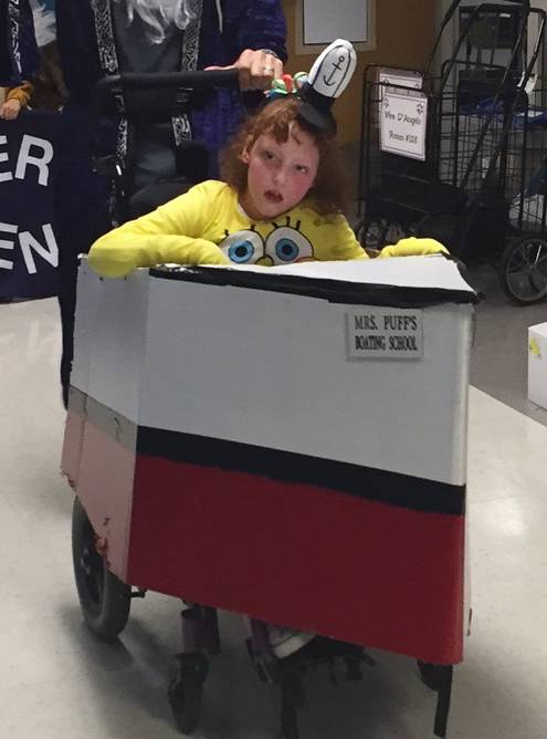 Always decked out in fancy costumes made by her dad, Metra mechanic Jeff Jendreas, 10-year-old Hope Jendreas of Elmhurst gets her wheelchair transformed. This year, she's the cartoon character SpongeBob and her chair is a boat from Mrs. Puffs Boating School.