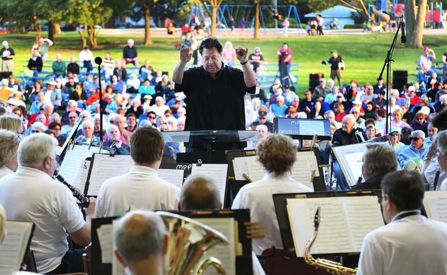 Conductor Ralph Wilder leads the Mount Prospect Community Band in a salute to John Philip Sousa at Veterans´ Memorial Band Shell in Lions Park.