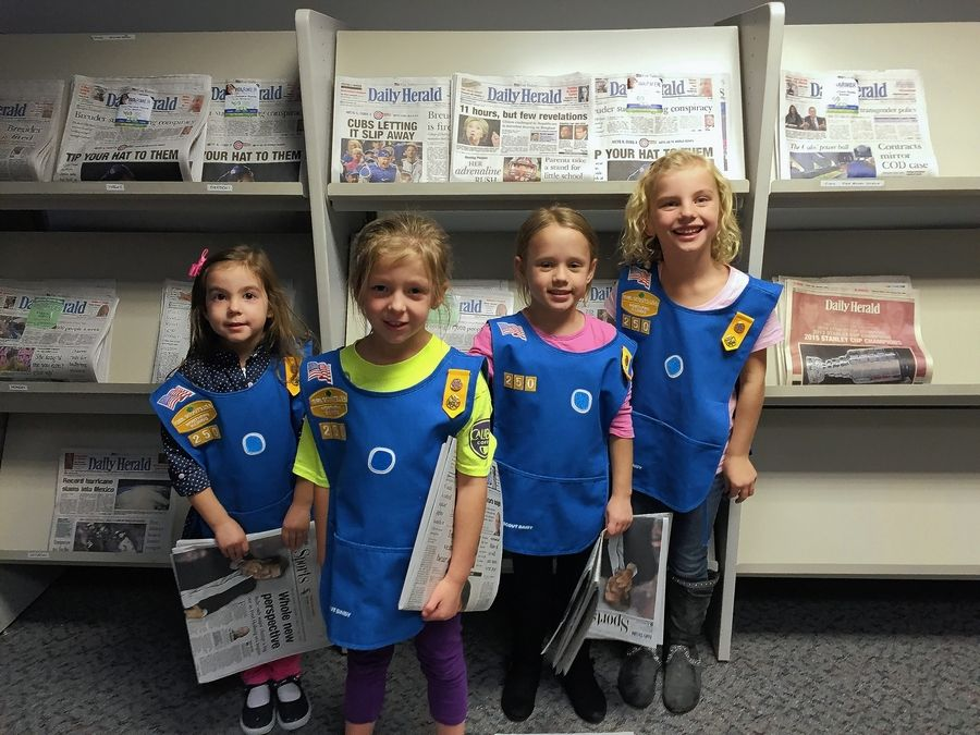 Members of Daisy Troop 250, all kindergartners from Leggee Elementary School in Huntley, earned their first 'petals' in a visit to the Daily Herald.