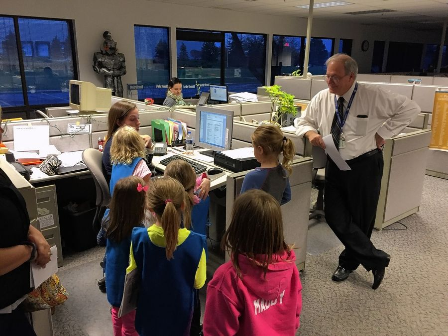 Reporter Lauren Rohr tells members of Daisy Troop 250 in Huntley about a story she's working on.