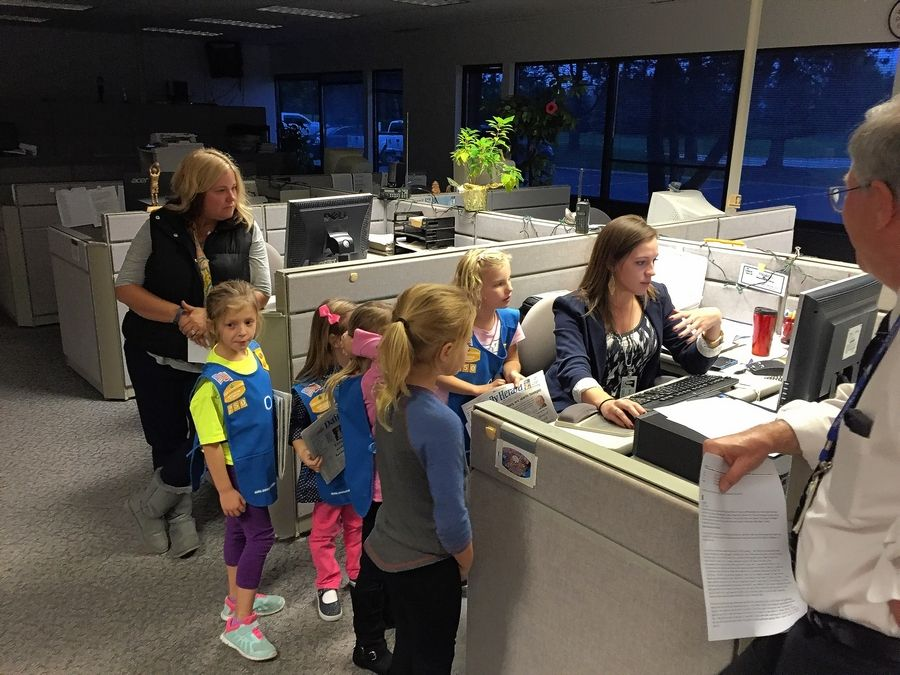 Members of Daisy Troop 250 in Huntley grill reporter Lauren Rohr about honesty and fairness in the news-gathering business.