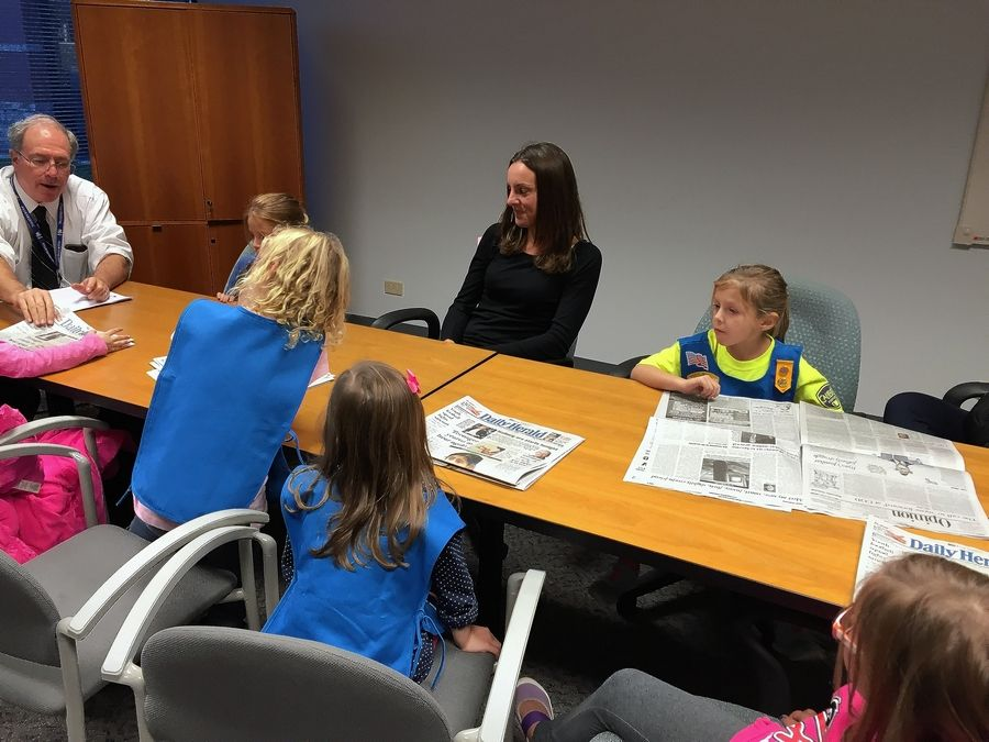 DuPage Fox Valley News Director Jim Davis discusses the Daily Herald's front page with members of Daisy Troop 250 in Huntley -- and their moms.