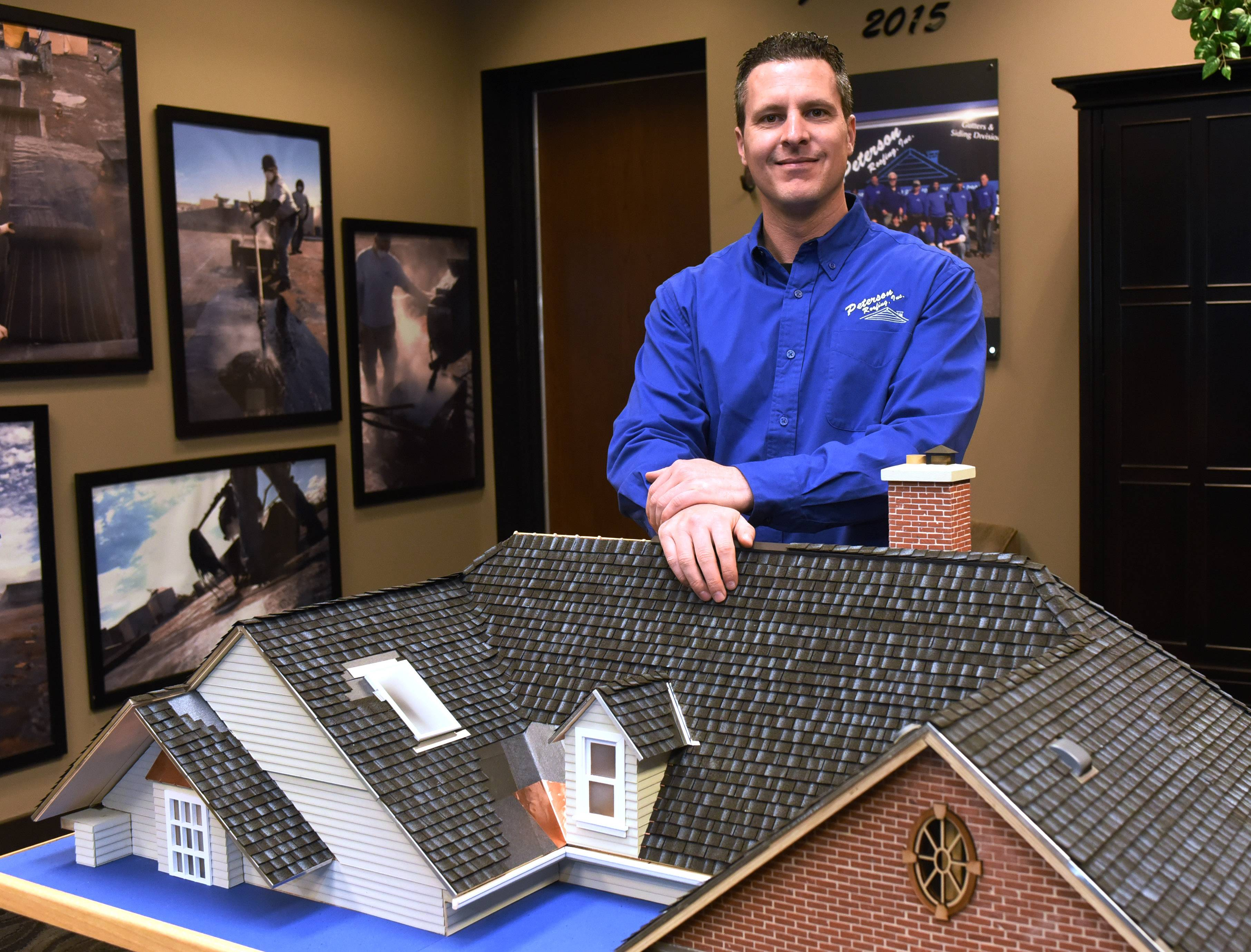 Delightful Jim Peterson Jr. Stands Beside A House Model In The Showroom At Peterson  Roofing In
