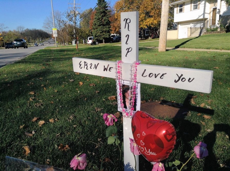 "A roadside memorial along Springinsguth Road in Schaumburg honors Erin Semerad of Schaumburg. one of two people killed in a two-car collision nearby last week. ""She was one of the sweetest human beings I've ever known,"" her mother said."