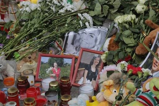 Portraits of plane crash victims are placed near flowers and toys at an entrance of Pulkovo airport outside St. Petersburg, Russia, Wednesday, Nov. 4, 2015. A Russian official says families have identified the bodies of 33 victims killed in Saturday's plane crash over Egypt. The Russian jet crashed over the Sinai Peninsula early Saturday, killing all 224 people on board. Most of them were holidaymakers from Russia's St. Petersburg.