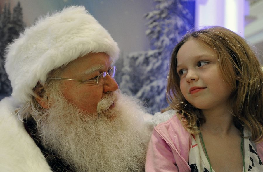 Kelsey Harrigan, 7, of Schaumburg visits with Santa at the Woodfield Mall as he arrived early from the North Pole to listen to all the wishes of the good boys and girls.