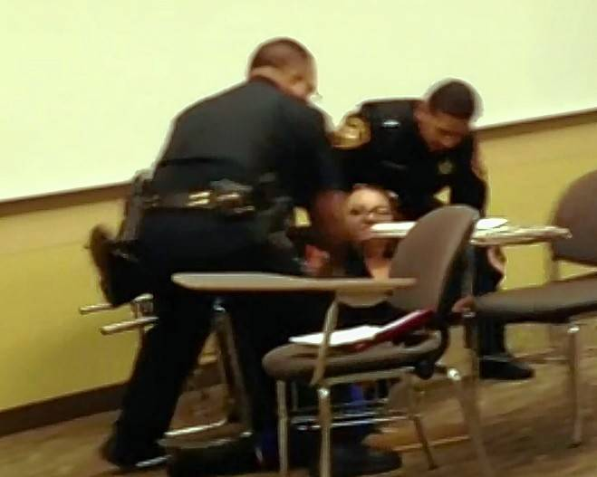 A former College of DuPage student, 27-year-old Jaclyn Pazera of Willowbrook, has filed a federal lawsuit alleging campus police used excessive force while arresting her in December 2014 while she sat in a philosophy classroom. Her attorney released a video of the confrontation on Thursday.