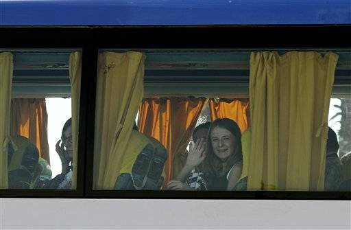 A tourists waves from a tourist bus at the main entrance to the Sharm el-Sheikh airport in Egypt on Saturday, Nov. 7, 2015. Egypt's Foreign Minister Sameh Shoukry complained on Saturday that Western governments had not sufficiently helped Egypt in its war on terrorism and had not shared relevant intelligence with Cairo regarding the downed Russian airplane that crashed last week in the Sinai, killing 224 people onboard.