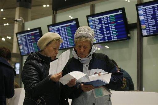 Passengers check documents to return their tickets to Egypt, or exchange for a flight to Turkey at Pulkovo airport outside St. Petersburg, Russia, Saturday, Nov. 7, 2015. Russia on Friday, Nov. 6, suspended all passenger flights to Egypt after days of resisting U.S. and British suggestions that a bomb may have brought down a Russian plane in the Sinai Peninsula a week ago.