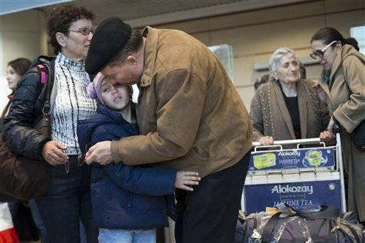 Travellers arrive back from Hurghada in Egypt, at Domodedovo airport in Moscow, Saturday, Nov. 7, 2015. Russia has banned all flights to Egypt until aviation security procedures improve but was allowing special flights to bring Russian tourists back home from Sharm el-Sheikh. A Russian Airbus A321-200 crashed 23 minutes after takeoff from the resort on Oct. 31, killing all 224 people on board.