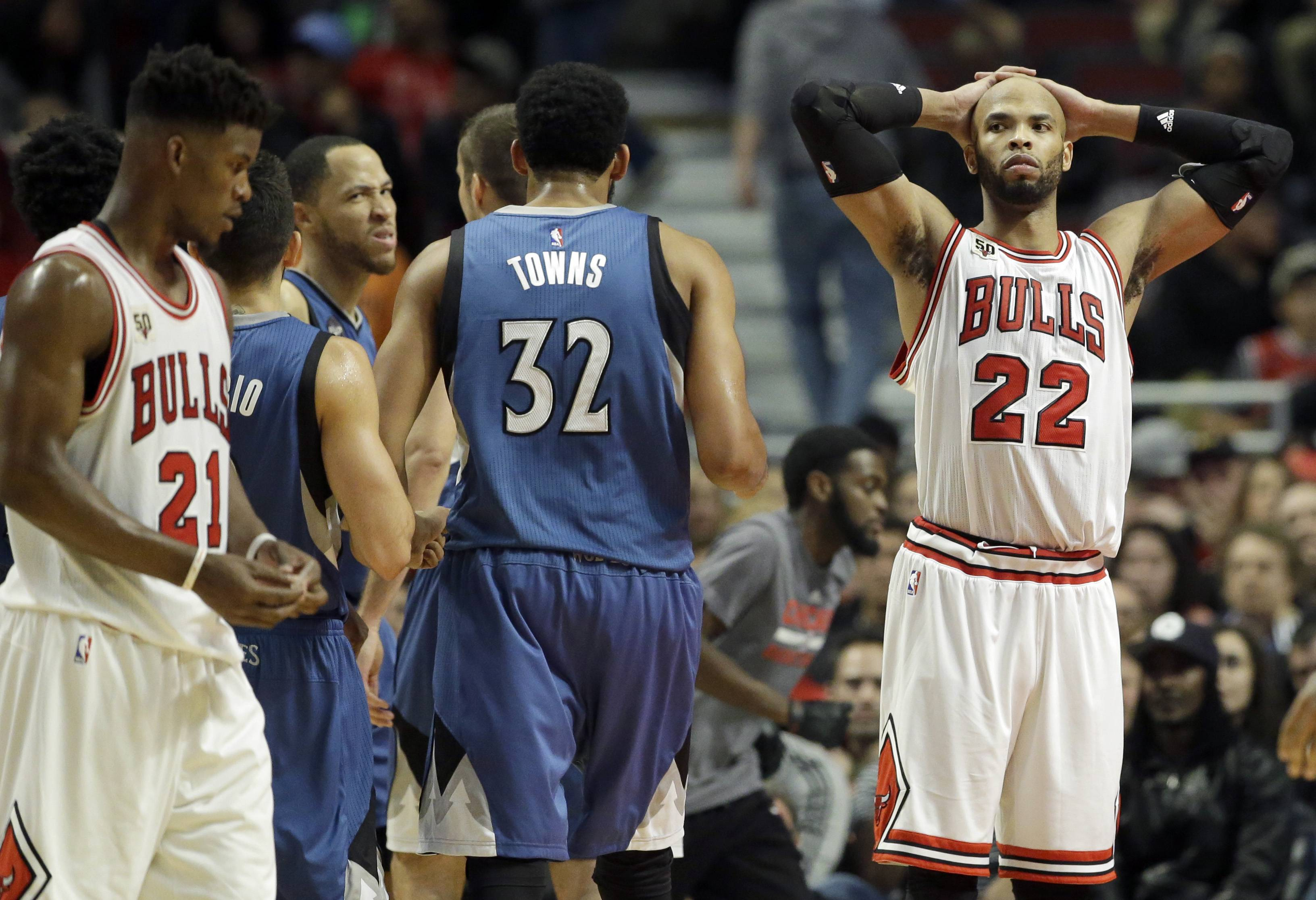 Chicago Bulls forward Taj Gibson (22) reacts as he looks to guard/forward Jimmy Butler (21) after Butler fouled Minnesota Timberwolves forward Tayshaun Prince during overtime Saturday night. The Bulls were shut out in OT and the Timberwolves won 102-93.