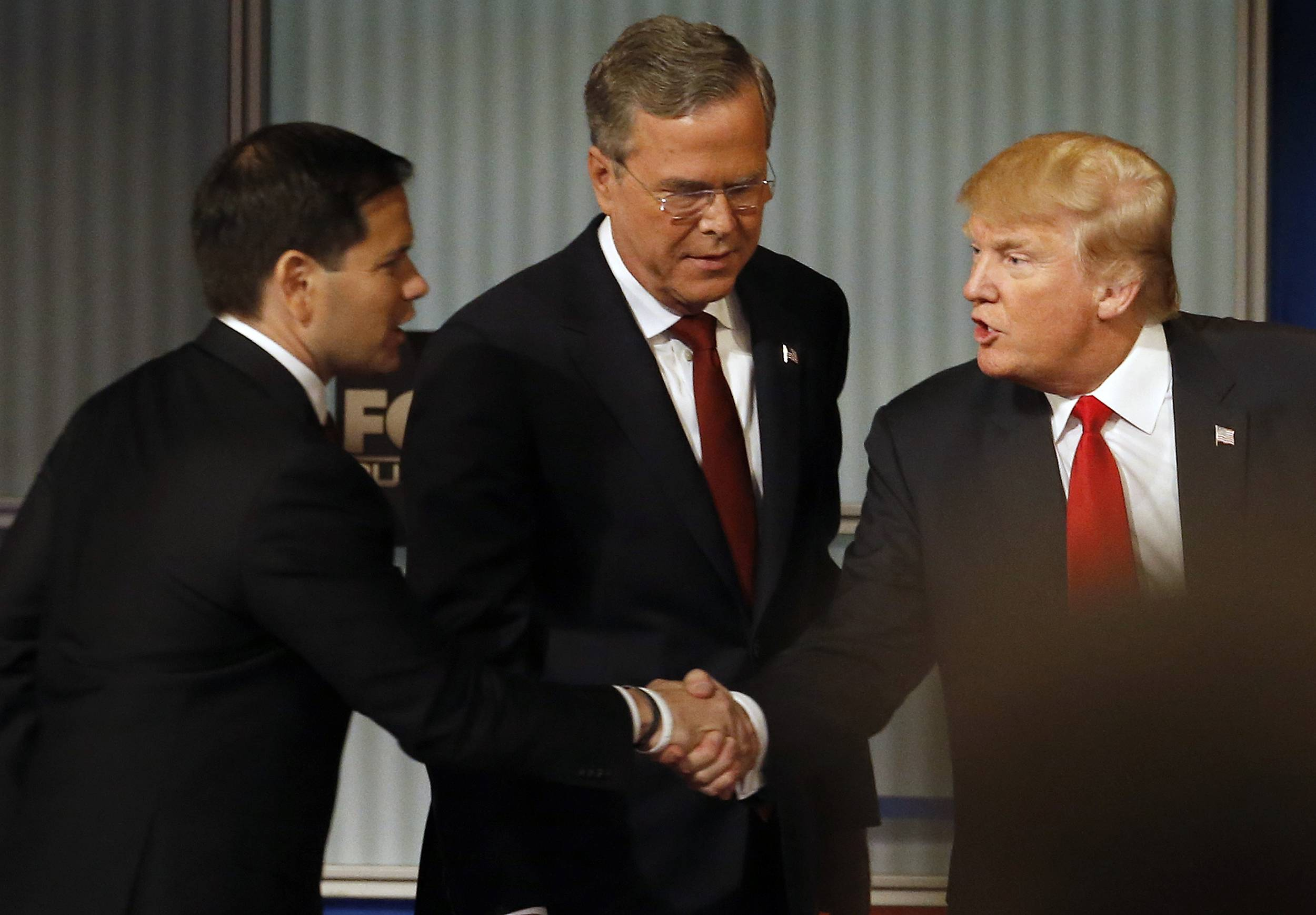 Marco Rubio and Donald Trump shake hands as Jeb Bush looks on during Republican presidential debate at Milwaukee Theatre, Tuesday, Nov. 10, 2015, in Milwaukee.