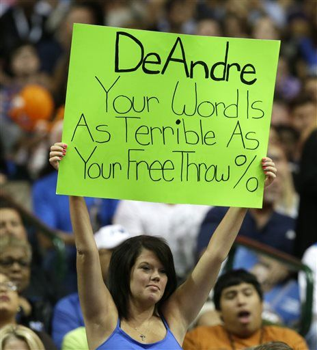 A fan in the stands holds up a sign about Los Angeles Clippers DeANdre Jordan during the second half of an NBA basketball game between the Clippers and the Dallas Mavericks on Wednesday, Nov. 11, 2015, in Dallas. The Mavericks won 118-108.