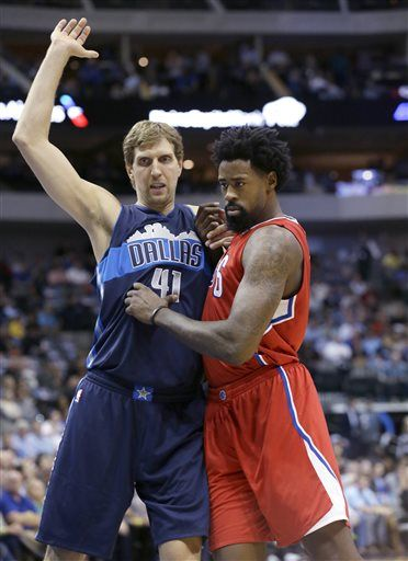 Los Angeles Clippers center DeAndre Jordan and Dallas Mavericks forward Dirk Nowitzki (41) of Germany jockey for position for an inbound pass during the first half an NBA basketball game Wednesday, Nov. 11, 2015, in Dallas.