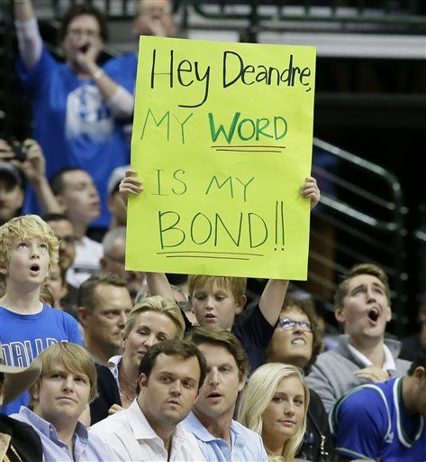 A young fans holds up a sign during the first half of an NBA basketball game between the Los Angeles Clippers and the Dallas Mavericks Wednesday, Nov. 11, 2015, in Dallas.