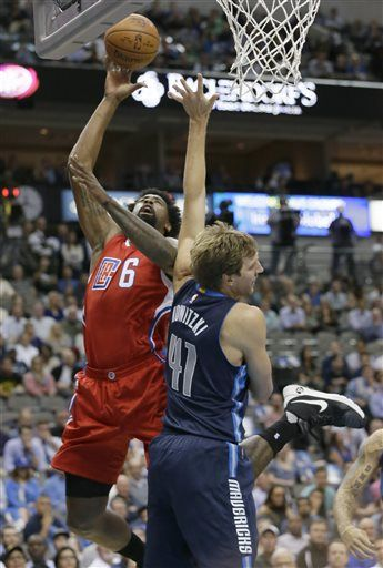 Los Angeles Clippers center DeAndre Jordan (6) scores against Dallas Mavericks forward Dirk Nowitzki (41) during the first half of an NBA basketball game Wednesday, Nov. 11, 2015, in Dallas.
