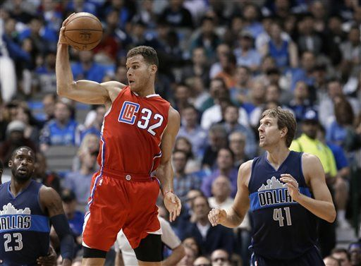 Los Angeles Clippers forward Blake Griffin (32) grabs a loose ball in front of Dallas Mavericks forward Dirk Nowitzki (41) during the first half of an NBA basketball game Wednesday, Nov. 11, 2015, in Dallas.