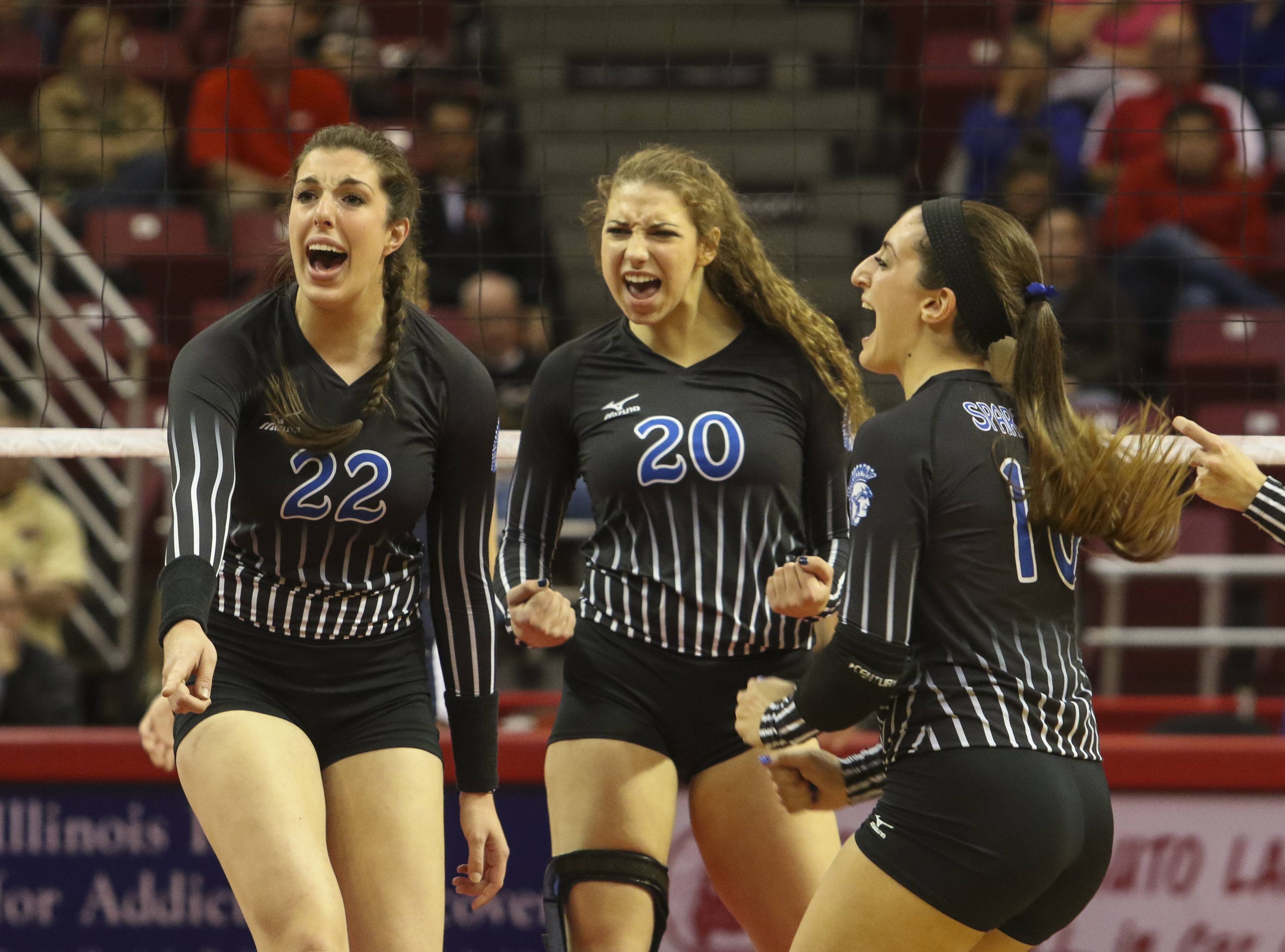 Left to right, Kamryn Malloy, Cat Wilson and Daniele Messa of St. Francis celebrate during their 2-0 win over Cary-Grove during Class 4A girls volleyball semifinal on Friday in Normal.
