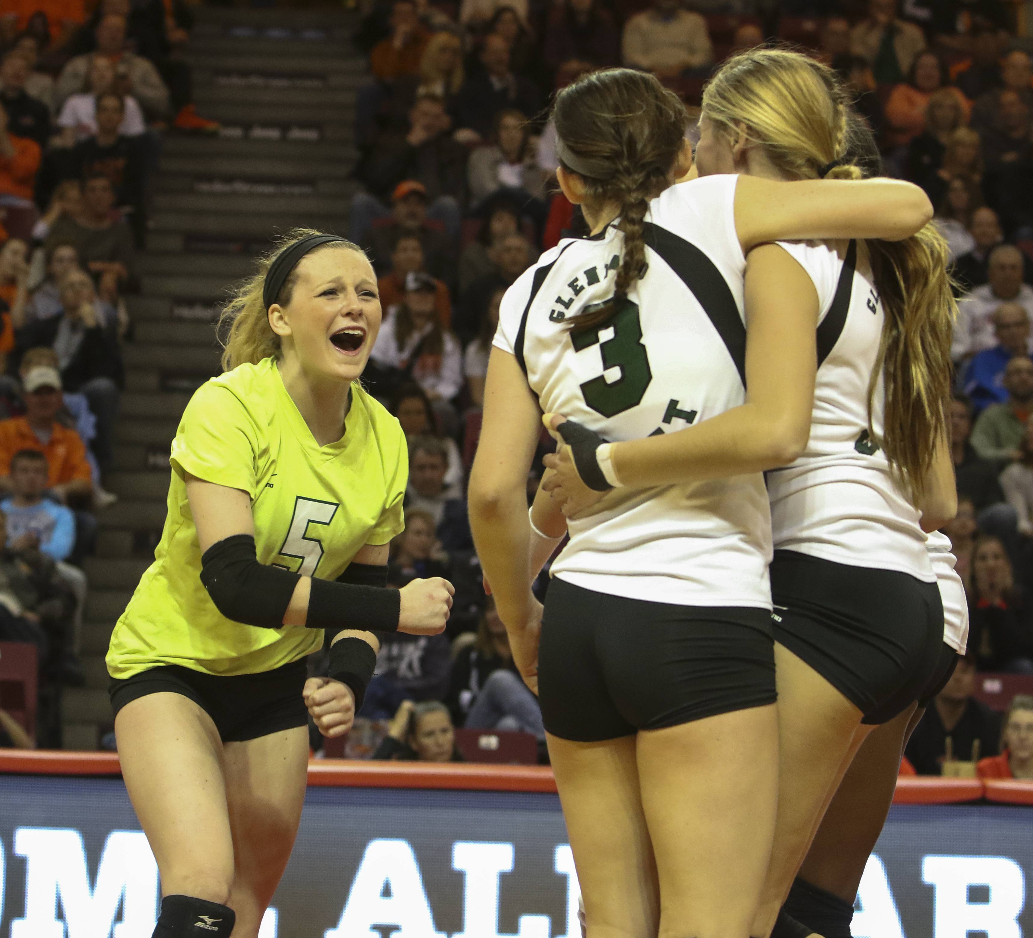 Claire Wagner of Glenbard West, left, celebrates during their win over Normal during a Class 4A girls volleyball semifinal on Friday in Normal.