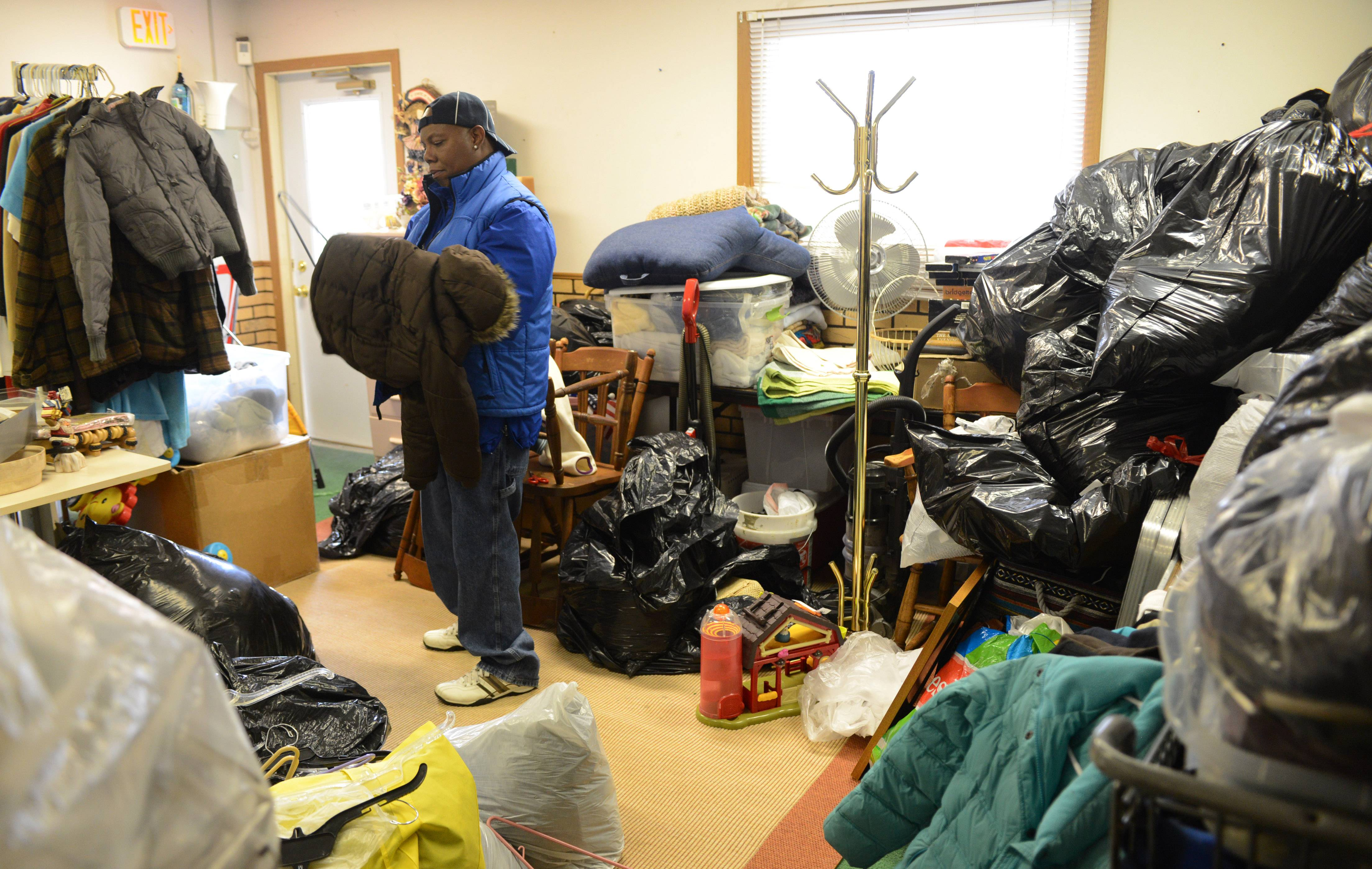 Volunteer Tony Hodges of North Chicago organizes coats to be given away at the Midwest Veterans Closet in North Chicago.