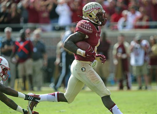 Florida State's Dalvin Cook scores against North Carolina State in the first quarter of an NCAA college football game, Saturday, Nov. 14, 2015 in Tallahassee, Fla.