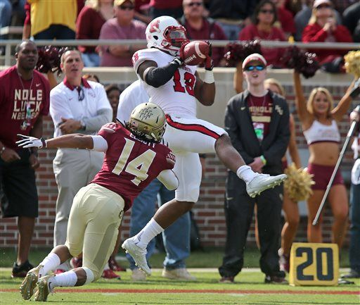 North Carolina State's Bra'Lon Cherry makes a reception as Florida State's Javien Elliot closes in for the tackle in the first quarter of an NCAA college football game, Saturday, Nov. 14, 2015 in Tallahassee, Fla.