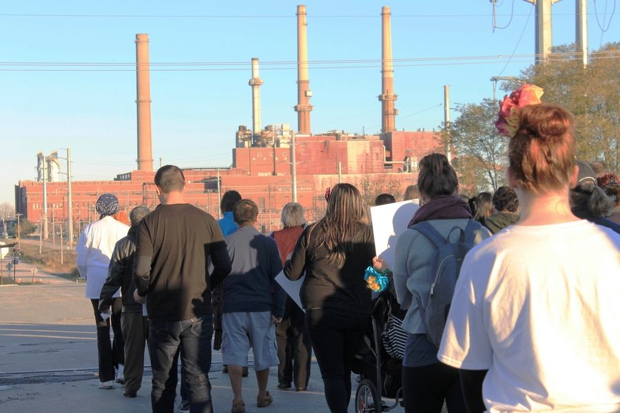 About 150 Lake County residents converge on the NRG Energy coal-fired power plant on Waukegan's lakefront to stage a vigil for environmental justice. Photo by Karen Long MacLeod/Clean Power Lake County Campaign.