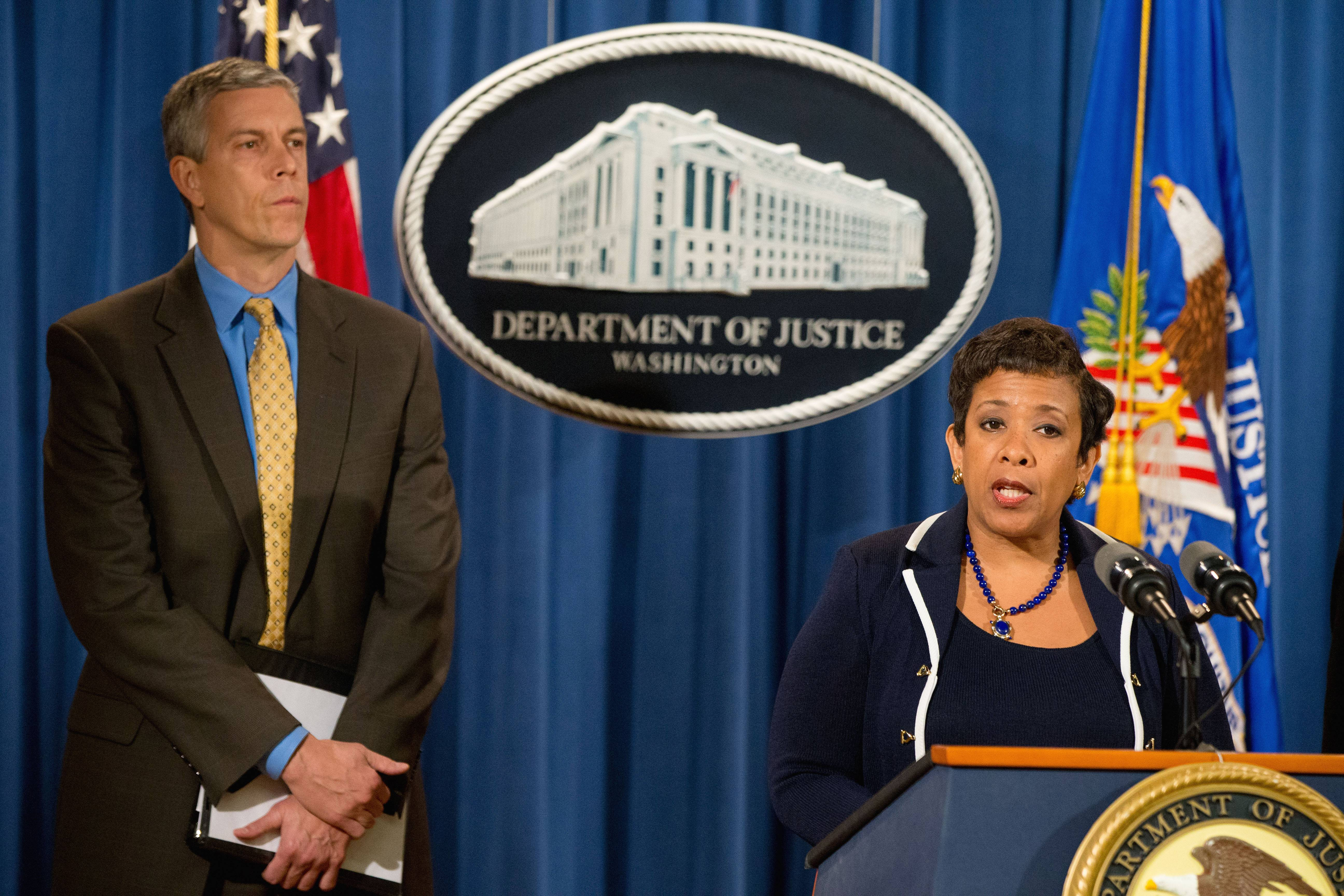 Attorney General Loretta Lynch, accompanied by Education Secretary Arne Duncan, speaks at a news conference at the Justice Department in Washington, Monday, Nov. 16, 2015, to announce a major federal and state civil litigation settlement concerning Educational Management Corp., a Pittsburgh-based company that runs for-profit trade schools.