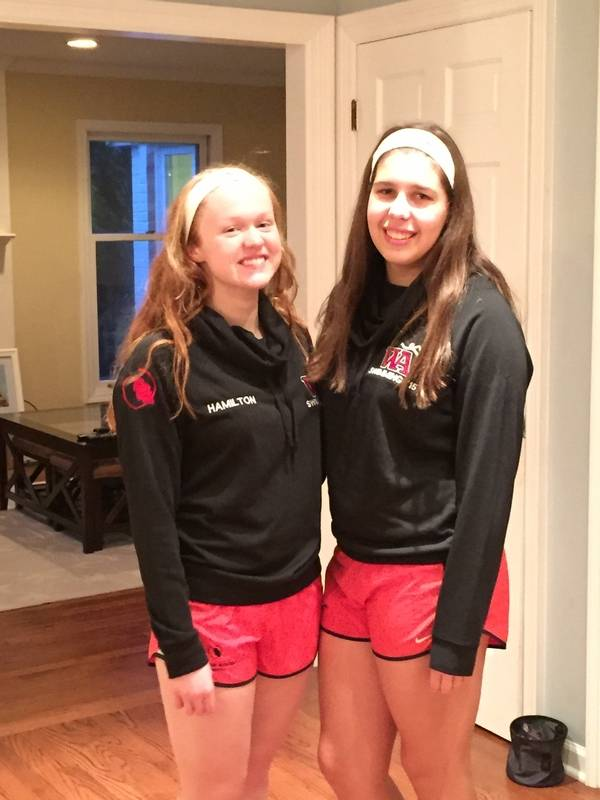 Woodlands Academy swim team members Caylee Hamilton, left, and Mary Pinn  competed in the