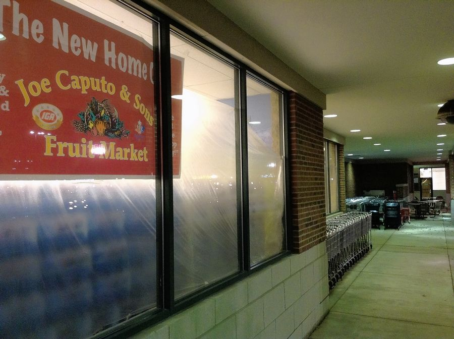 Plastic sheets cover most windows at the new Joe Caputo & Sons in Elk Grove Village, but its opening is expected Friday.