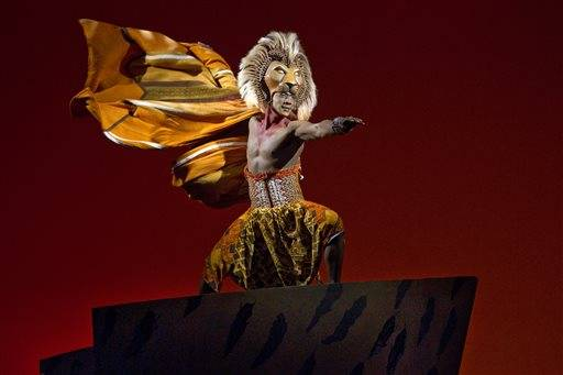 "This image released by Disney Theatrical Productions shows Jelany Remy as Simba in the Broadway musical ""The Lion King. The Disney stage blockbuster on Wednesday, Nov. 18, 2015, released 360-degree footage of its opening song ""Circle of Life� that lets users look left, right, up, backstage and at the audience even when sitting on a couch. (Joan Marcus/ Disney Theatrical Productions via AP)"