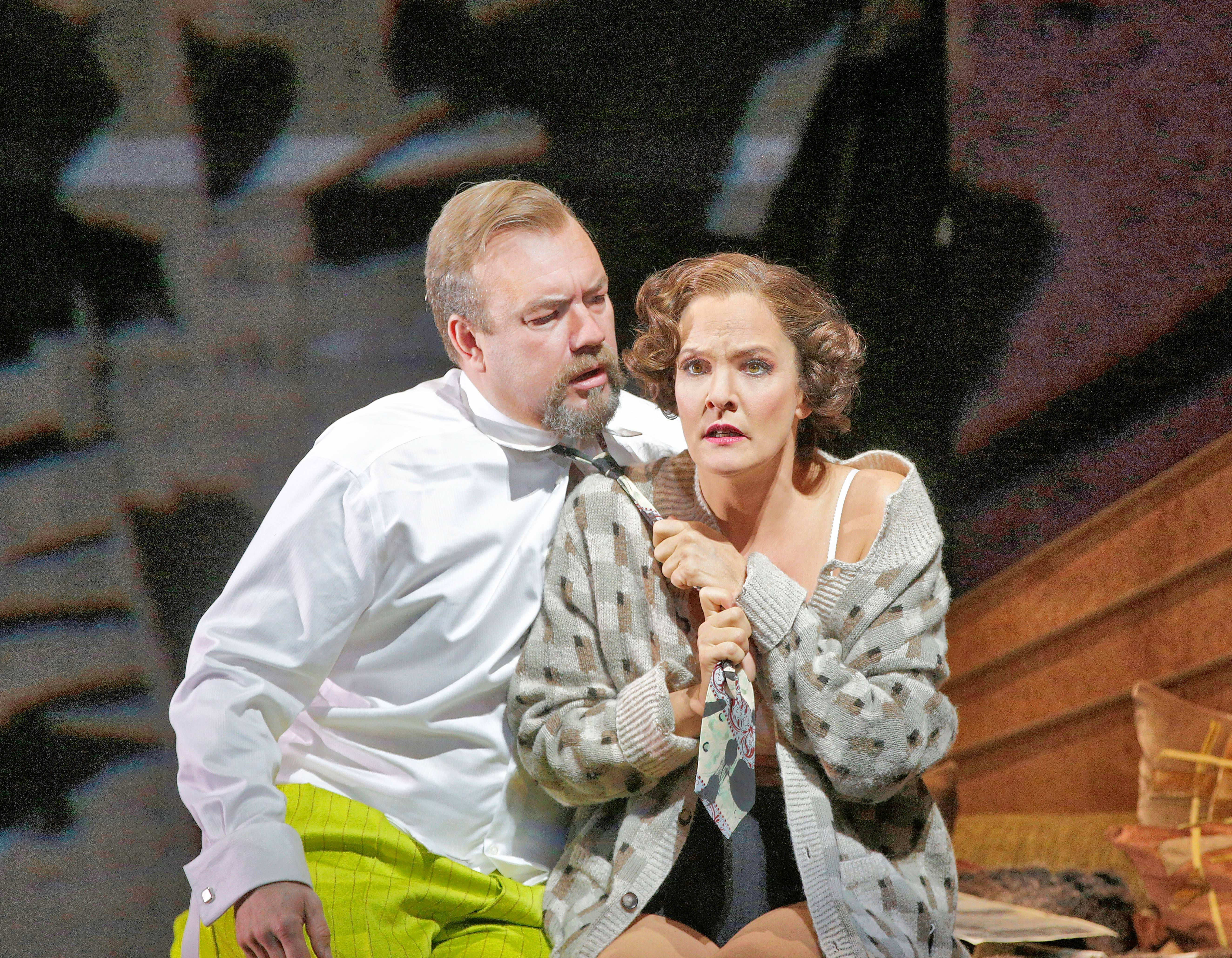 "Lulu (Maris Petersen) demands that her lover, Dr. Schon (Johan Reuter), abandon his respectable fiancee in artist William Kentridge's new production of ""Lulu"" for the Metropolitan Opera. Berg's tragic opera plays in select movie theaters on Saturday, Nov. 21."