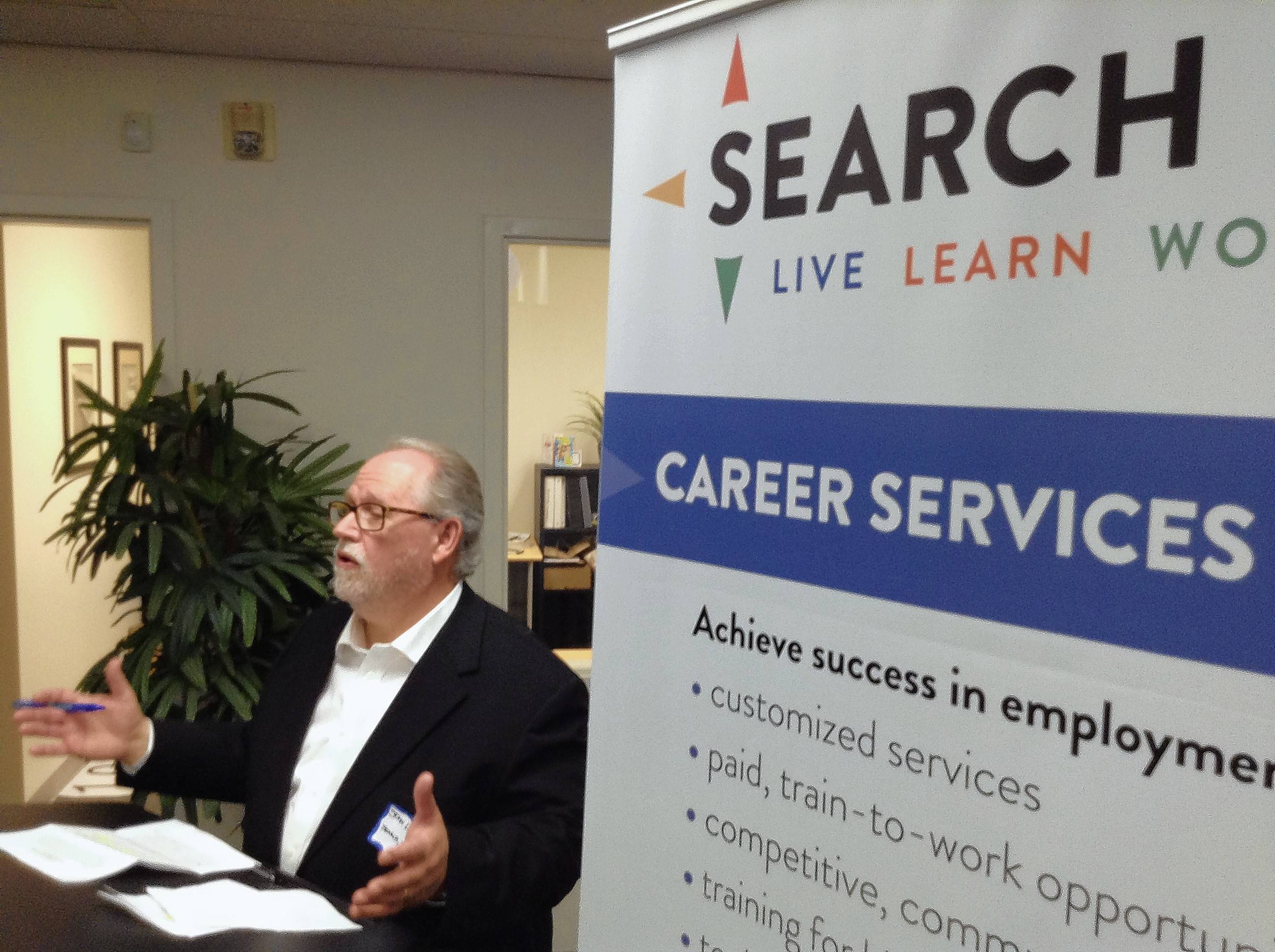John Lipscomb, CEO of Search Inc., speaks before the ribbon cutting for a 63,000-square-foot warehouse in Des Plaines for subsidiary firm Planet Access Co. Search provides services to those with developmental disabilities, including job training and placement.