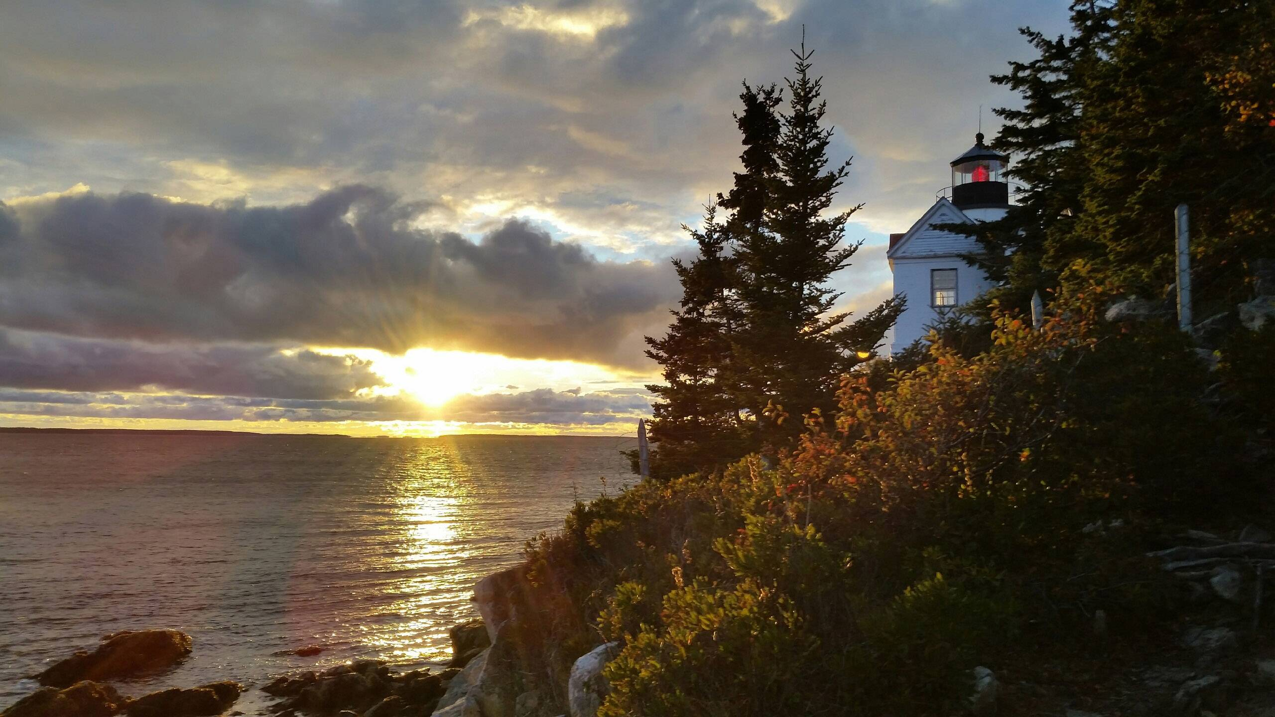 The sun sets over a lighthouse in Bass Harbor, in Bar Harbor Maine, in October 15.