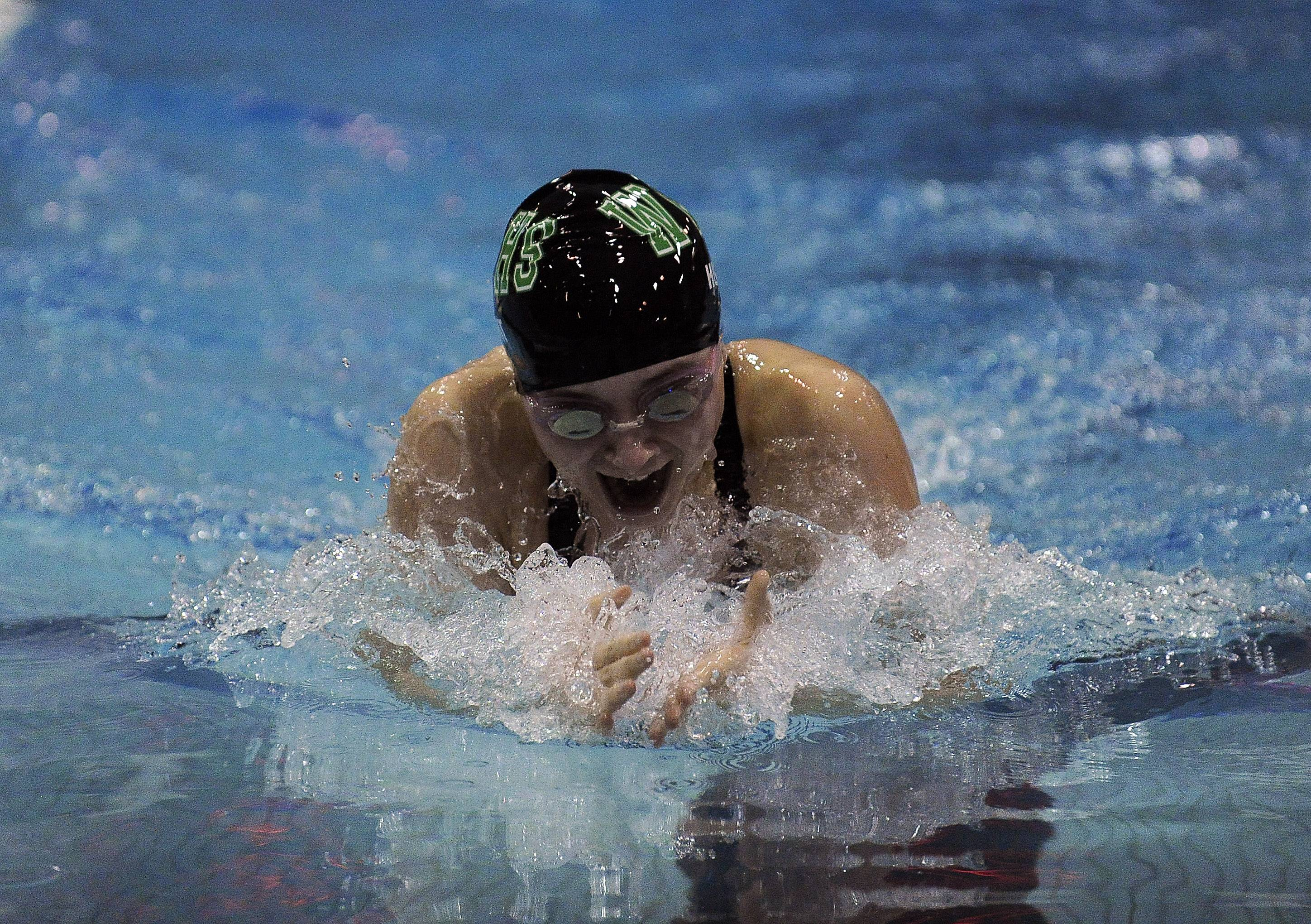 Waubonsie Valley's Hannah Hunt plows through the water in the 100-yard Breaststroke at the IHSA State Swimming & Diving Championship Prelims at New Trier High School on Friday.