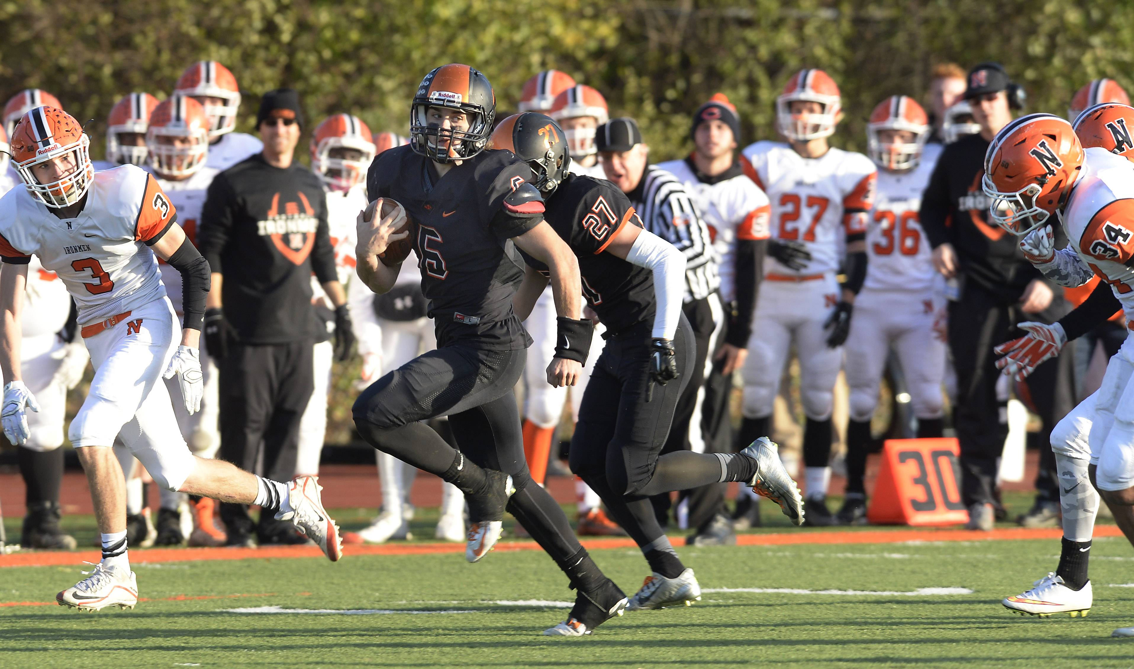 Libertyville quarterback Riley Lees sails into the end zone for a fourth-quarter touchdown in the Class 7A state quarterfinal game against Normal Community last week. The Wildcats travel to Bradley-Bourbonnais Saturday for the semifinals.