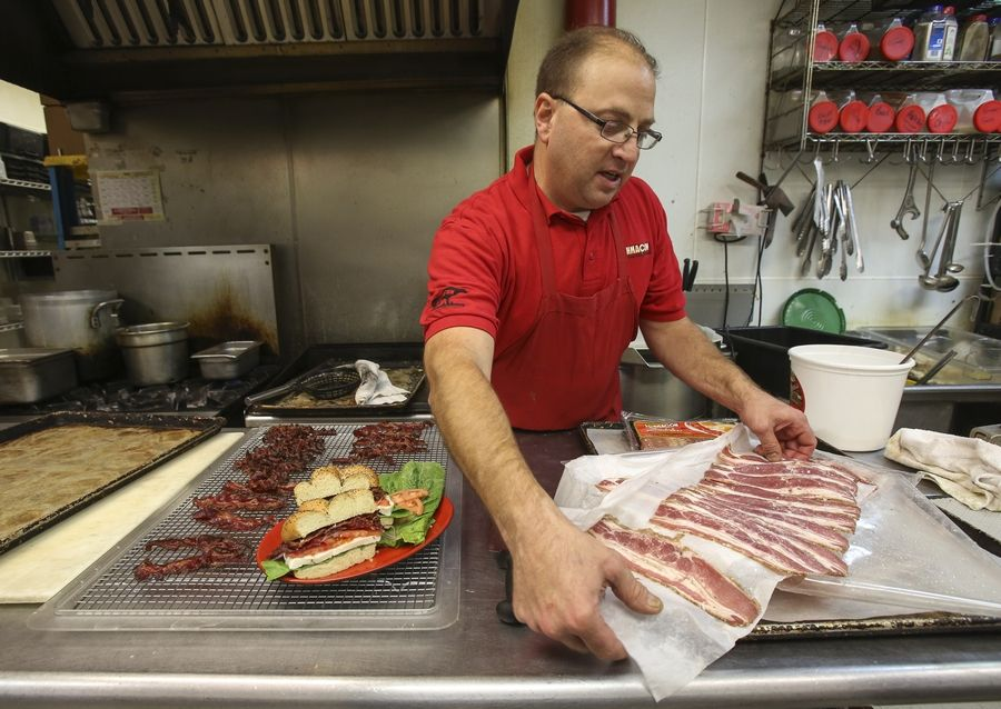 Howard Bender, owner of Schmaltz Deli in Naperville, prepares to bake a batch of Schmacon, a beef version of bacon that he invented a few years ago and now is selling in grocery stores.
