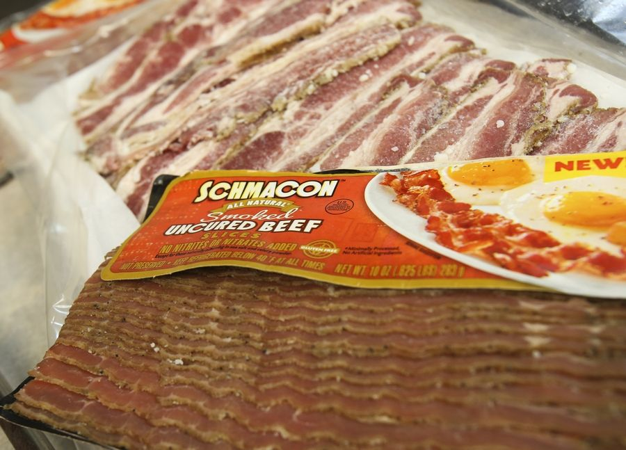 "Schmacon, invented by Schmaltz Deli owner Howard Bender, is uncured whole-muscle beef slices that are marinated and smoked to taste like ""beef's answer to bacon."" Schmacon is now for sale at grocery stores including Fresh Thyme, Valli Produce and Lemon Tree Grocer."