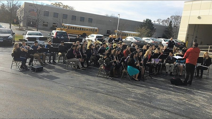 Warren Township High School band plays Friday outside AKHAN Semiconductor's Gurnee corporate headquarters and production facility as part of a celebration marking the company's move into a Gurnee business park.
