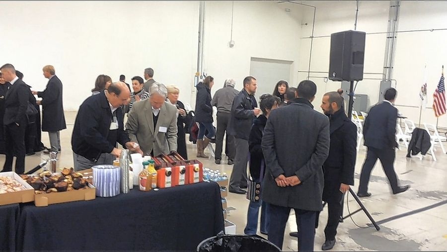 Guests mingle before celebrating AKHAN Semiconductor's move into a Gurnee business park just west of the Tri-State Tollway. The building is for AKHAN's corporate headquarters and production facility.