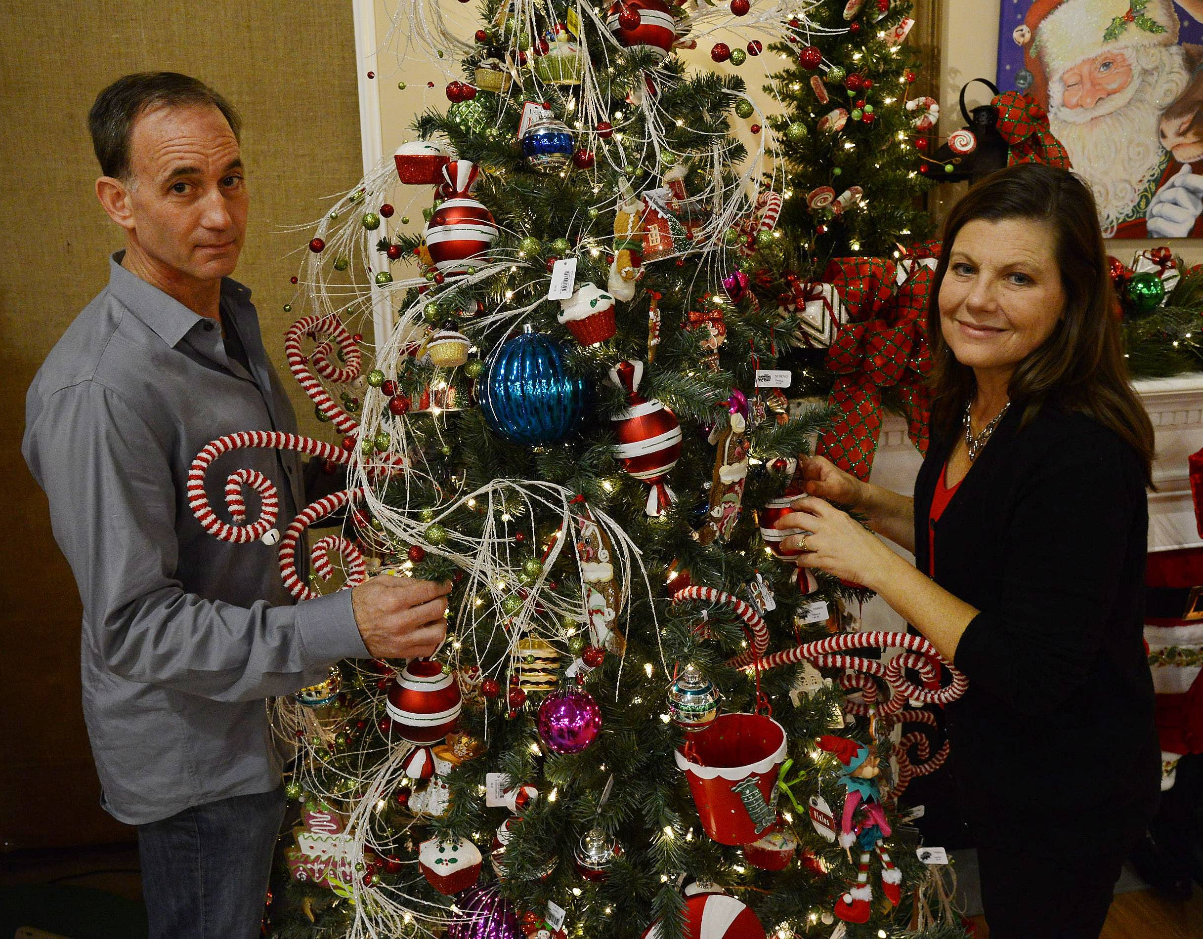 Joe and Laurie Kane work to make their store, Treetime Christmas Creations in Lake Barrington, an annual destination for shoppers.