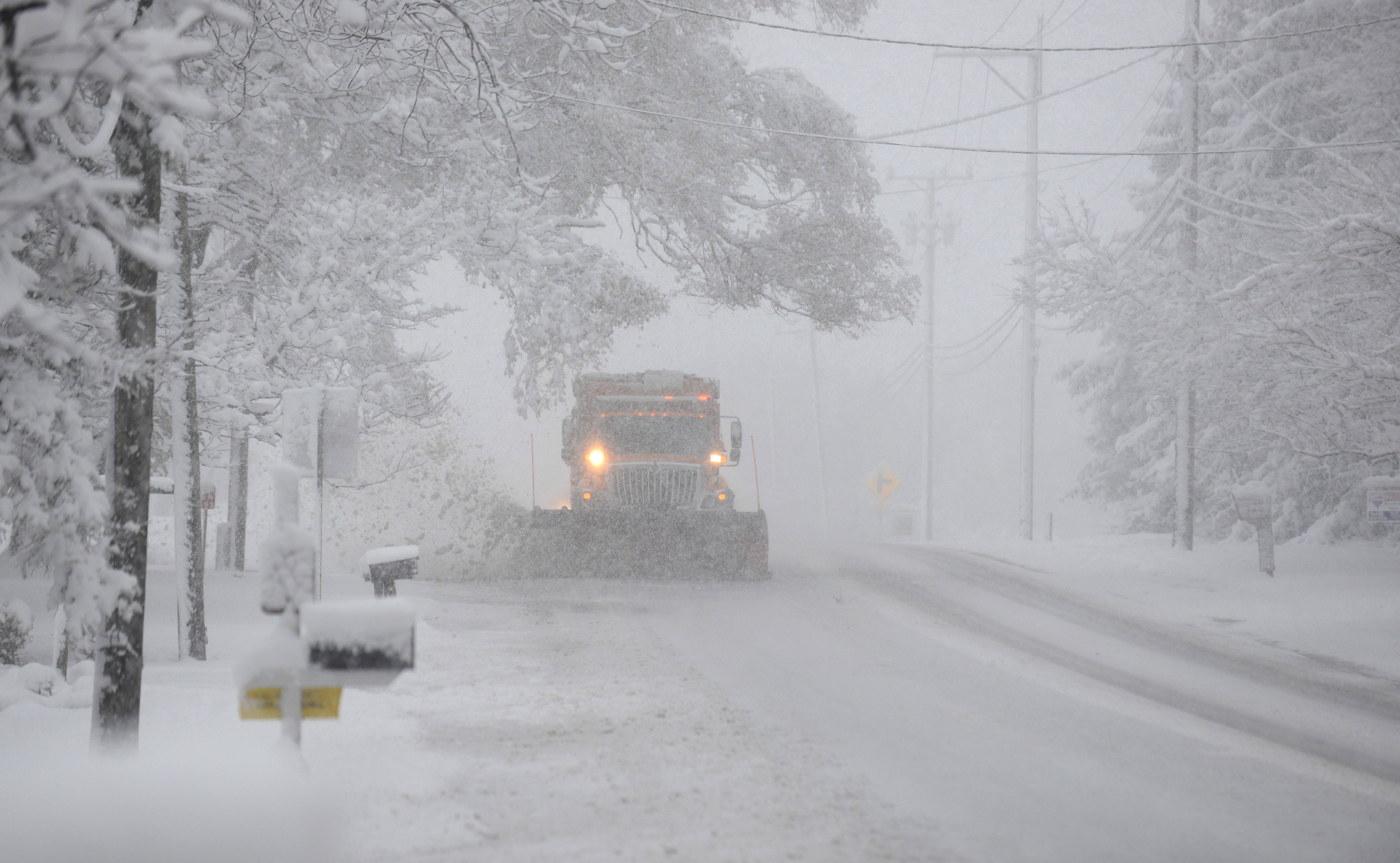 A snowplow clears the northbound lane on Route 47 in Lily Lake Saturday morning.