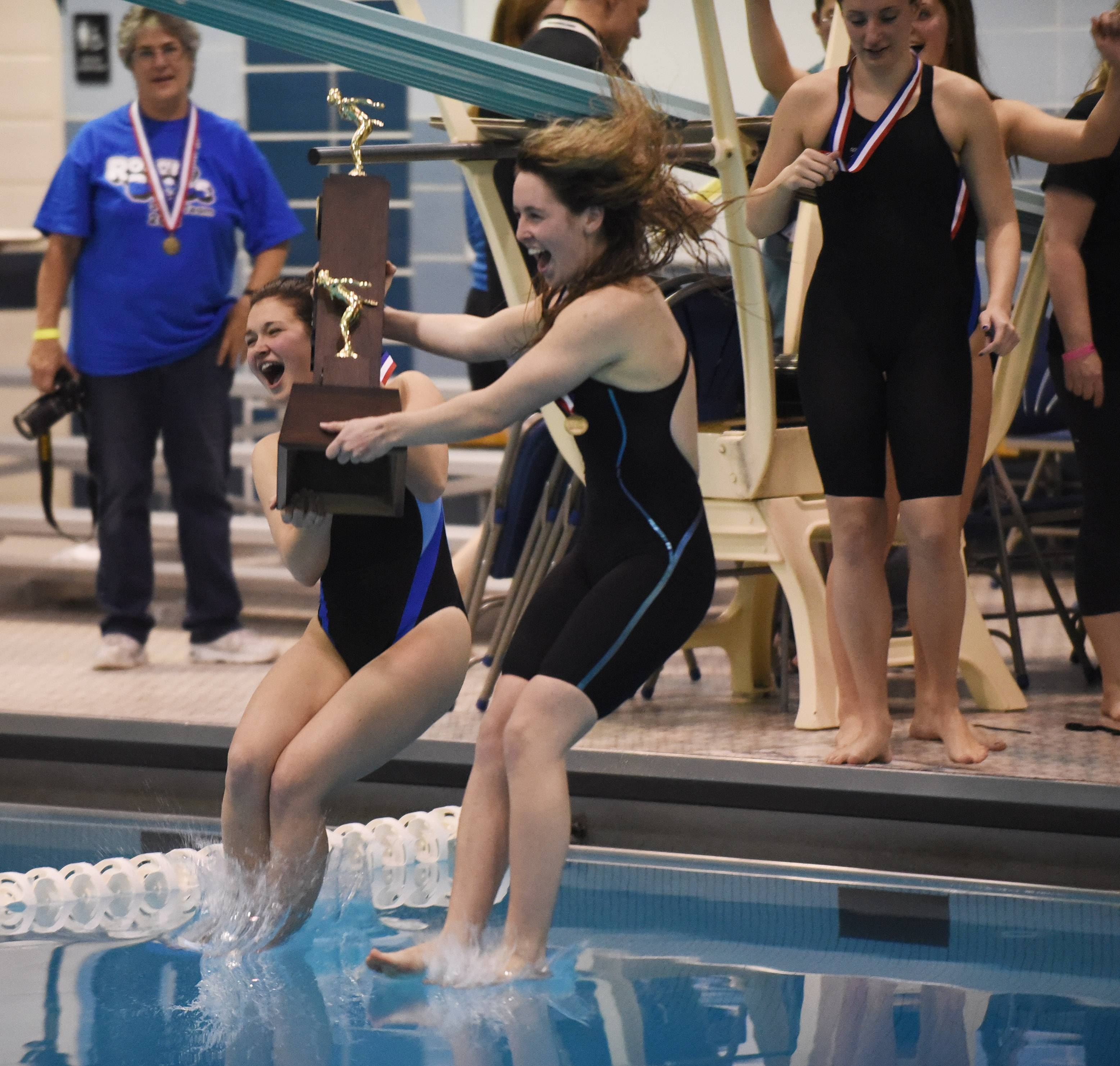 Rosary swimmers jump into the pool with their first-place trophy following the girls state swimming finals at New Trier High School in Winnetka Saturday.