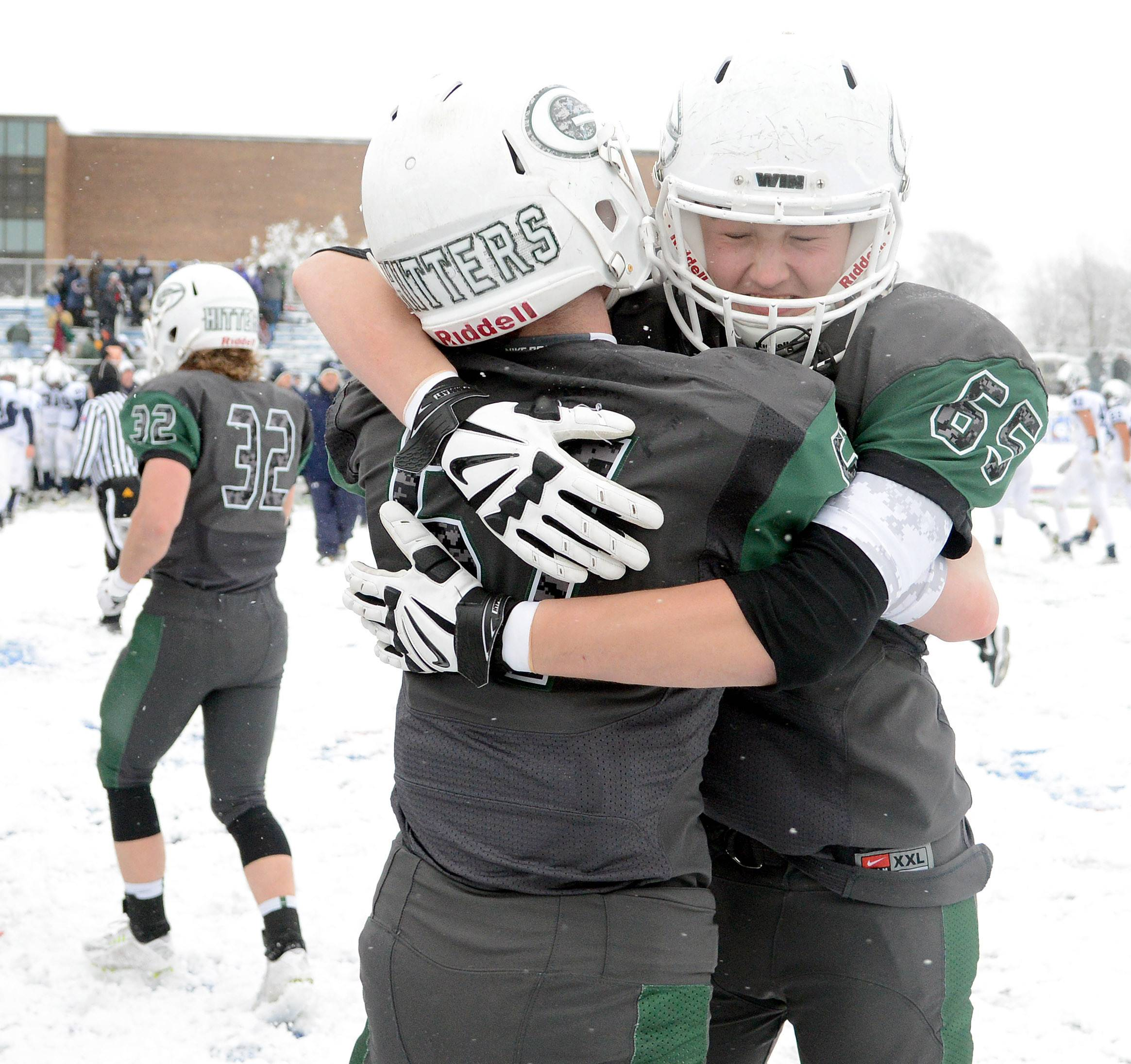 Glenbard West's Matt Skelton (57) and Jacob Johanson (65) celebrate their win over Cary-Grove in the Class 7A semifinal in Glen Ellyn Saturday.