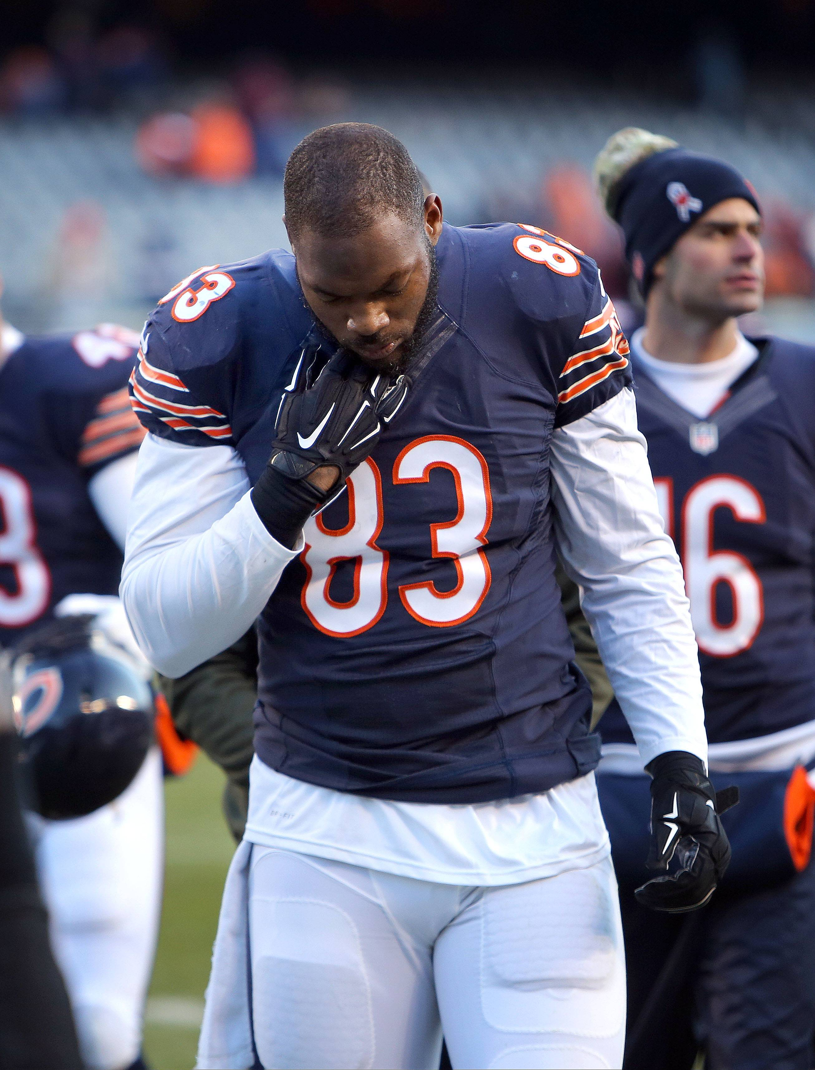 Bears tight end Martellus Bennett hangs his head after their 17-15 loss to the Broncos Sunday at Soldier Field.